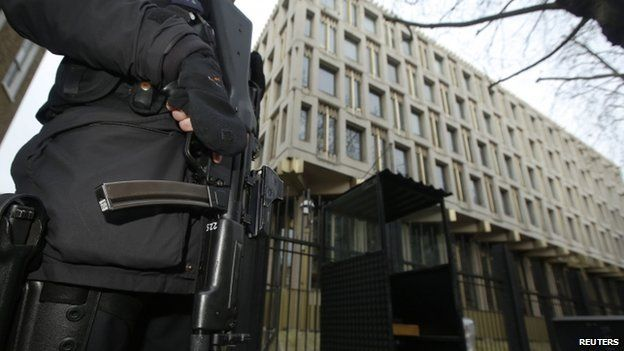 Armed police officer guards US embassy in London - 9 December