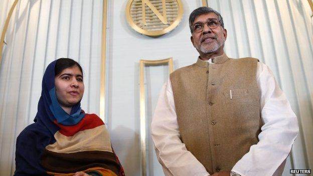 Nobel Peace Prize laureates Kailash Satyarthi (right) and Malala Yousafzai pose for photographers after a news conference in Oslo (9 December 2014)