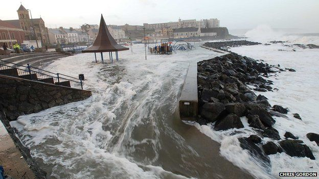 Sea water flooding over the land at Portstewart, Northern Ireland