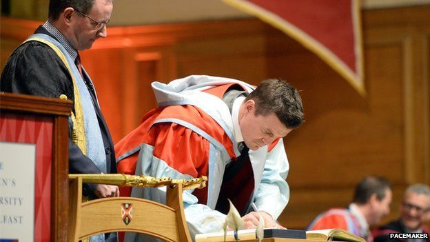 Brian O'Driscoll signs book at graduation ceremony at Queen's University Belfast