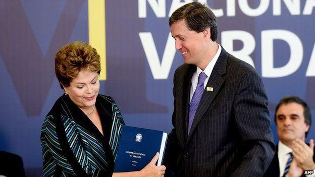 Brazilian President Dilma Rousseff receives the final report, 10 December, 2014.