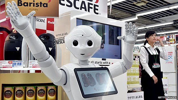 Pepper the robot puts in his 9-5 at a Tokyo electrics shop, selling Nestle coffee machines
