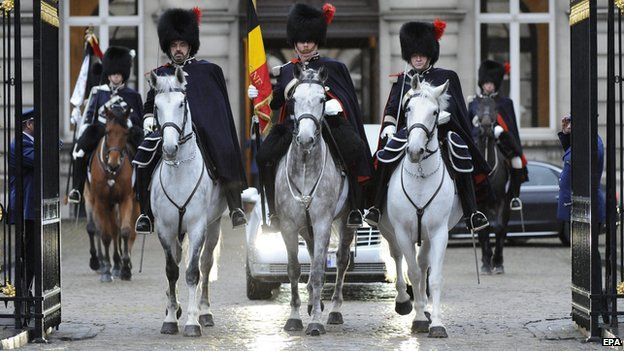 The cortege of late Belgian Queen Fabiola is escorted by mounted Royal Guards as it leaves Brussels Palace