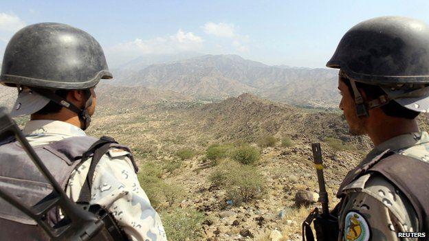 Saudi soldiers stand guard in Jizan on the border with Yemen November 3, 2014.