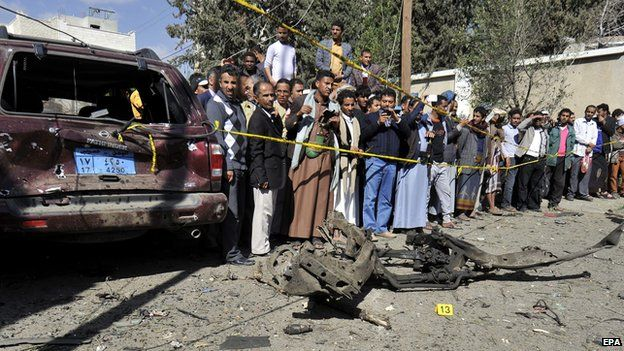 """Yemenis gather at the scene of a car bomb blast targeting the residence of the newly-appointed Iranian ambassador to Yemen, in Sana""""a, Yemen, 03 December 2014"""