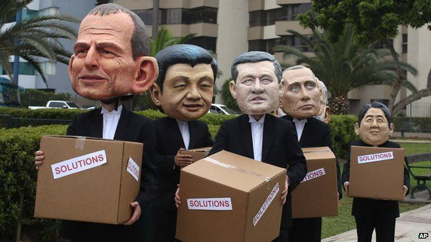 """Environmental activists perform representing leaders, from left, Australia""""s Prime Minister Tony Abbott, China""""s President Xi Jinping, Canada""""s Prime Minister Stephen Harper, Russia""""s President Vladimir Putin and Japan""""s Prime Minister Shinzo Abe during the Climate Change Conference COP20, in Lima Peru, Friday, Dec. 12, 2014."""