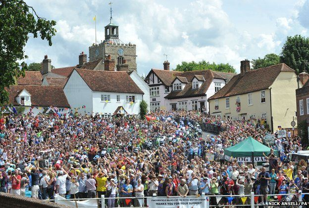 Riders make their way up the short climb in the village of Finchingfield in north Essex during stage three of the Tour de France from Cambridge to London