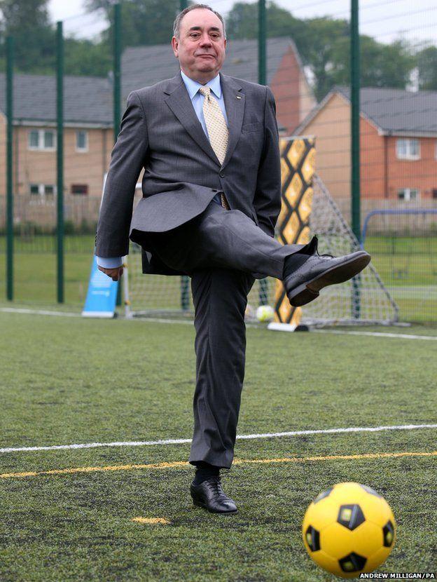 Scotland's First Minister Alex Salmond kicks a ball during a Street Soccer Scotland photocall