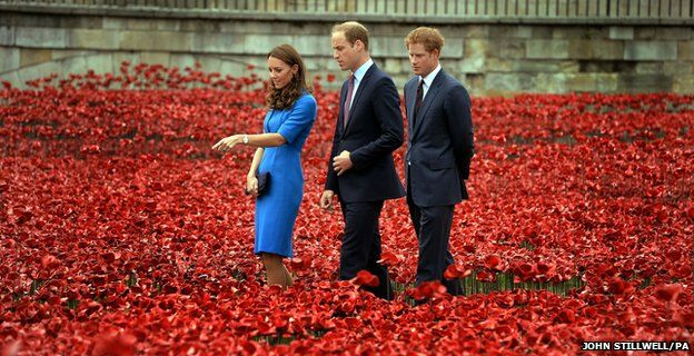 The Duke and Duchess of Cambridge accompanied by Prince Harry view the Tower of London's Blood Swept Lands and Seas of Red poppy installation