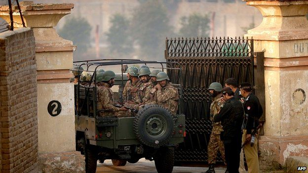 Soldiers stand guard at school gate in Peshawar. 17 Dec 2014