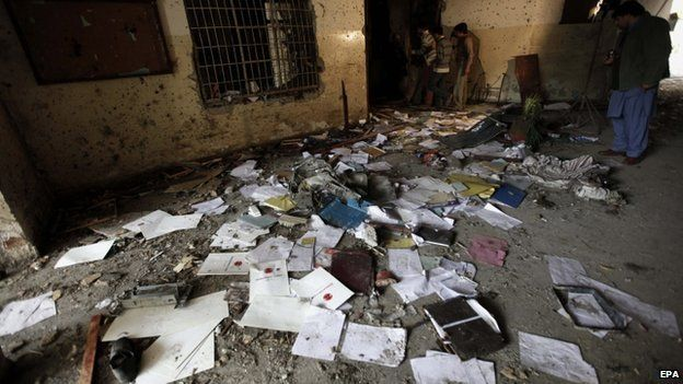 Pakistani security officials inspect the premises of Army Public School that was attacked by the Taliban militants in Peshawar, Pakistan, 17 December 2014.