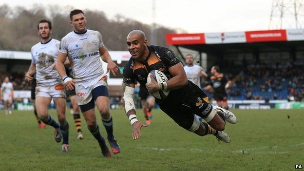 Wasps' Tom Varndell scores a try during the club's final match at Wycombe's Adams Park