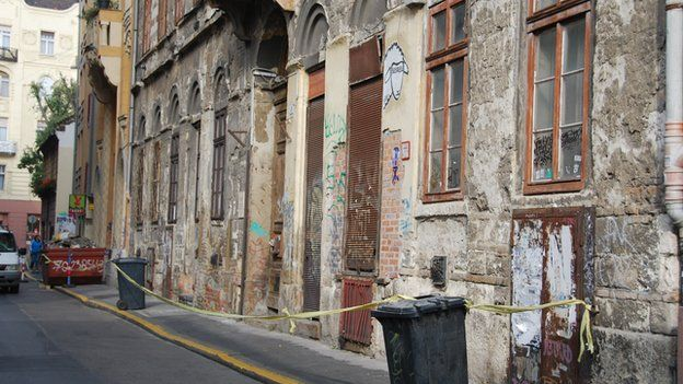 Street in Budapest with cordon to warn people of falling plaster