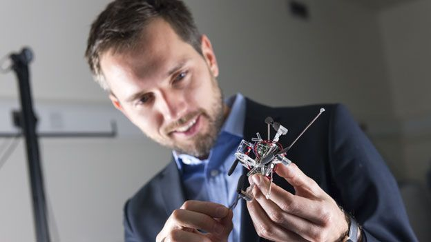 Imperial College London's Dr Mirko Kovacs in the university's Aerial Robotics Lab with one of Imperial's next generation flying robots