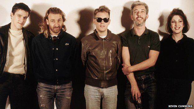 Rob Gretton (second from right) with New Order