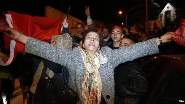 Supporters of the Presidential candidate Beji Caid Essebsi, leader of the Nidaa Tounes party shout slogans celebrate the first results of the Tunisian elections