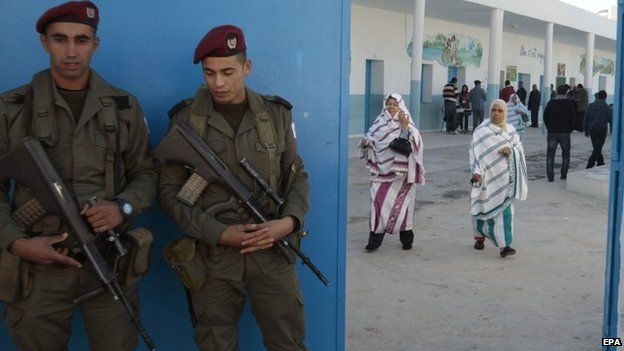 Soldiers stand guard during Tunisia's historic presidential elections