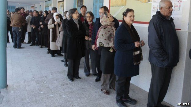 Tunisians queue to vote in the country's historic presidential elections