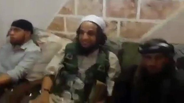Frame from IS video appearing to show IS fighters discussing obtaining female slaves