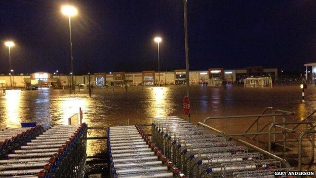 Dozens rescued from flooded Asda store in Kilmarnock - BBC News