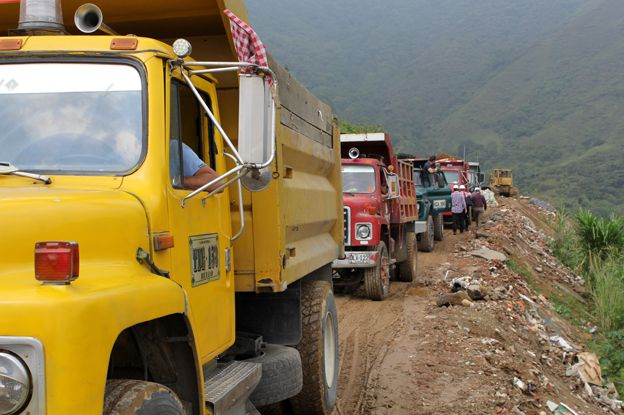 Lorries carry construction waste to parts of the dump