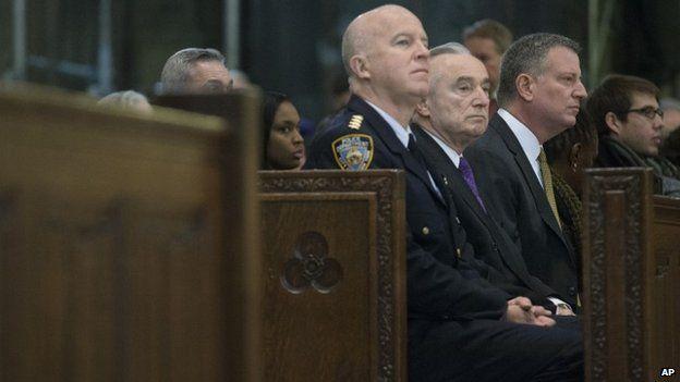 Bratton (centre) and De Blasio (right) attended a church memorial service