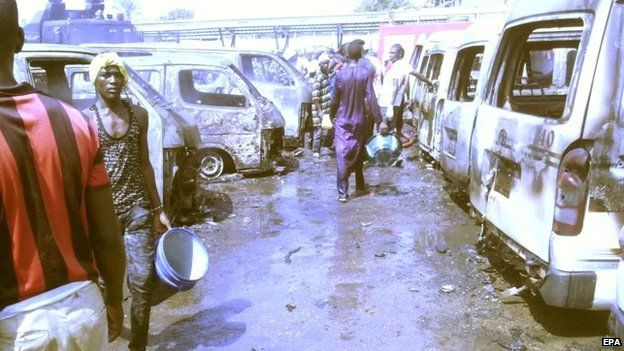 People inspect the site of a bomb blast at a bus station in Gombe, north-eastern Nigeria - 31 October 2014