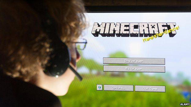 Boy playing Minecraft