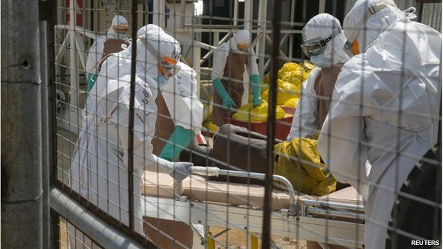 British health workers with an Ebola patient near Freetown, Sierra Leone, 22 December 2014