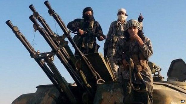 Photo from Raqqa Media Centre showing Islamic State fighters with anti-aircraft gun