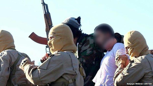 Photo posted online by Raqqa Media Center purportedly showing Jordanian pilot Flight Lieutenant Moaz Youssef al-Kasasbeh captured by Islamic State militants near the Syrian city of Raqqa (24 December 2014)