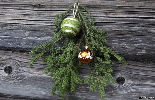 Christmas decorations on a wooden house