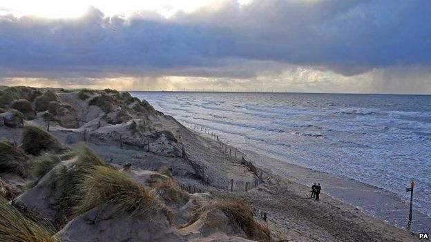 People going for a Christmas Day walk along Formby Point, Merseyside