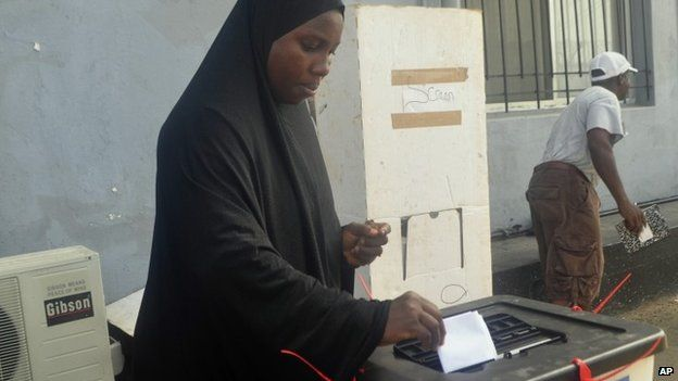 A Liberian woman casts her vote in senate elections