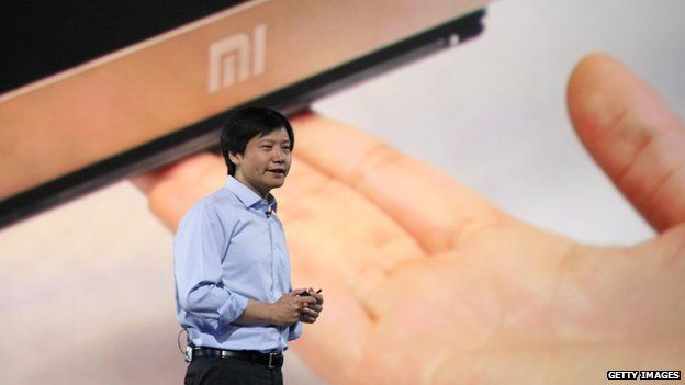 Xiaomi CEO Lei Jun speaks during a product launch