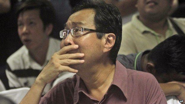 Relative of victim at Surabaya airport - 30 December
