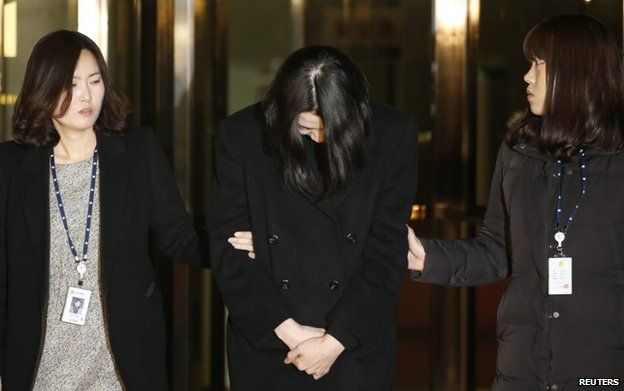 Cho Hyun-ah leaves for a detention facility after a Korean court ordered her to be detained, at the Seoul Western District Prosecutor's office on 30 December 2014