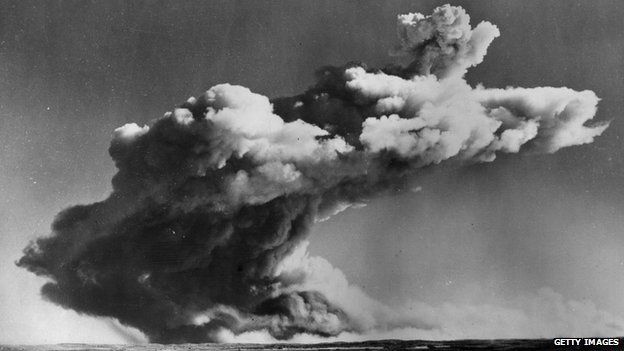 A drifting mushroom cloud hangs over the Monte Bello Islands off Western Australia, after Britain's first atomic bomb is tested