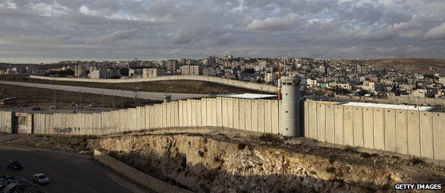 A general view shows a section of Israel's separation barrier in the West Bank village of Al-Ram on the outskirts of Jerusalem in December 2012