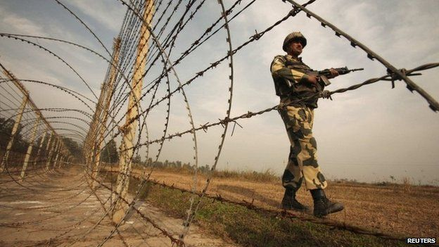 An Indian Border Security Force (BSF) soldier patrols near the fenced border with Pakistan in Suchetgarh, southwest of Jammu in this January 14, 2013 file picture