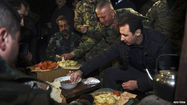 Syrian President Bashar al-Assad with troops in a Damascus suburb - 1 January
