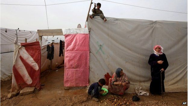 Syrian refugees at a camp in eastern Lebanon, December 2014