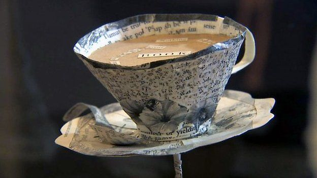 Paper sculpture of a teacup and saucer