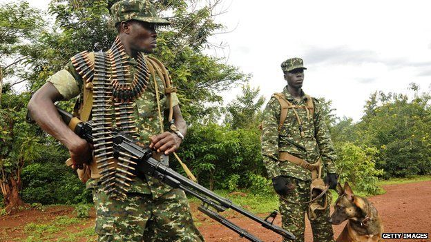 Ugandan soldiers under African Union (AU) command patrol as part of a mission to combat Lord's Resistance Army (LRA) rebels in Obo in the Central African Republic (CAR) on 13 May 2014