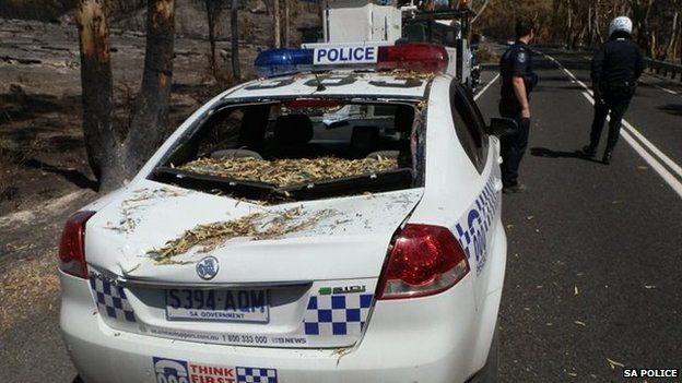 Crushed police car in South Australia (7 Jan 2014)