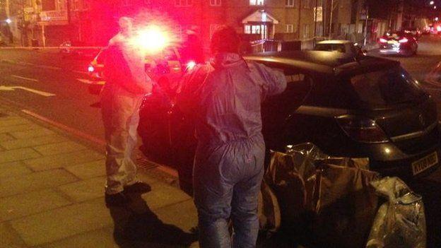 Forensic investigators at the scene