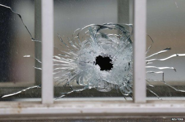 A bullet impact at the Charlie Hebdo office in Paris, 7 January