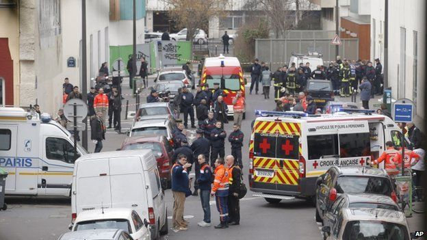 Ambulances gather in the street outside the French satirical newspaper Charlie Hebdo's office, in Paris, 7 January 2015.