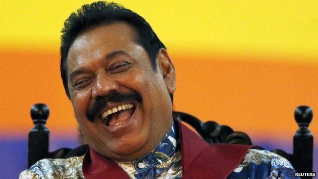 Sri Lankan President Mahinda Rajapaksa smiles during his final rally ahead of presidential election in Piliyandala January 5, 2015.