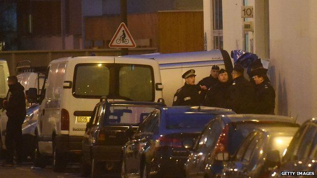 Police officers prepare to reportedly evacuate bodies from the offices of the French satirical newspaper Charlie Hebdo on Nicolas Appert Street on 7 January 2015 in Paris, France